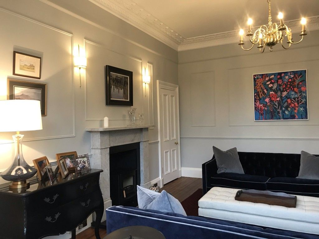 French-style wall panelling complements the beautiful Haresfield 3 seater sofa in Portland Velvet Navy with contrast piping in Portland Velvet Steel