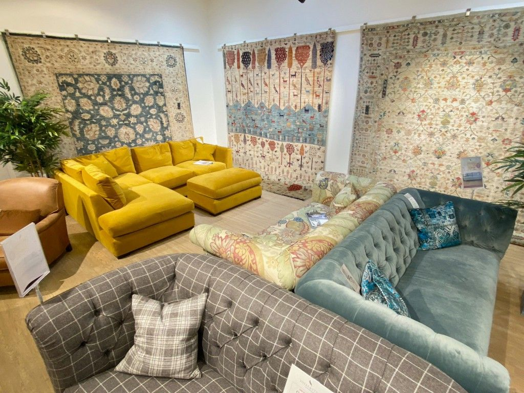 Rugs of Petworth handmade rugs hanging in our Henley-on-Thames sofa shop