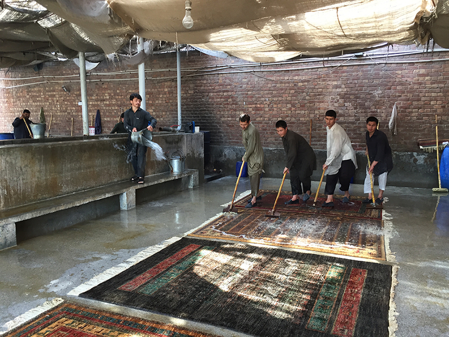Handmade rug being washed